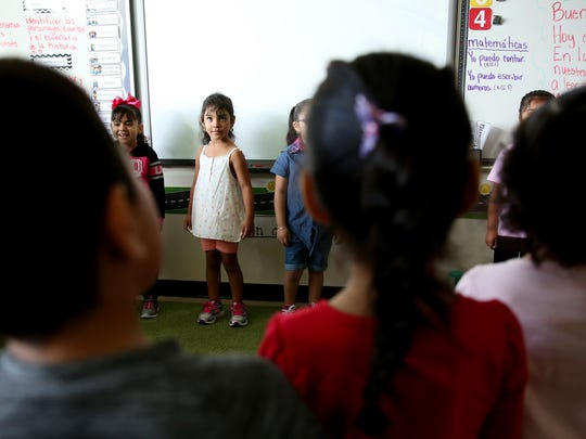 Kindergartners stand in a circle and introduce themselves at Chávez Elementary School in Salem on Wednesday, Sept. 13, 2017. Wednesday was the first day of school for kindergartners in Salem-Keizer.