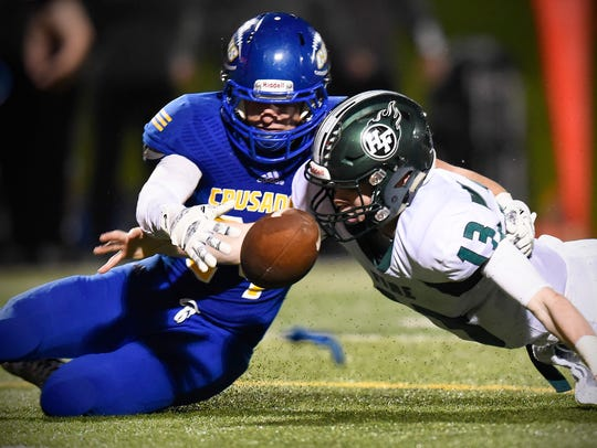 St. Cloud Cathedral's Ryan Tetzloff, left, recovers