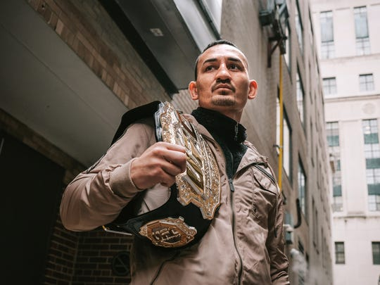 UFC featherweight champion Max Holloway poses with