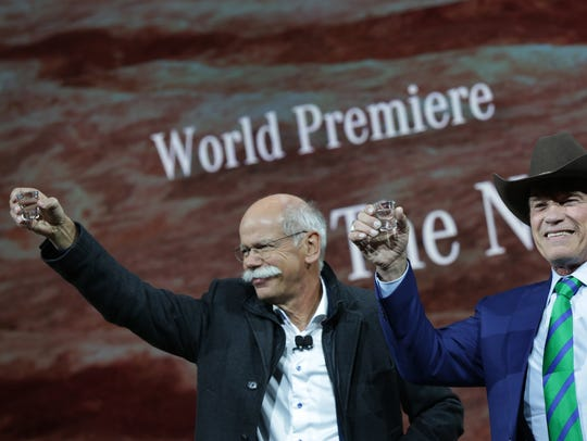 Daimler AG CEO Dieter Zetsche, left, is joined by Arnold Schwarzenegger for a toast during the unveiling of the updated Mercedes-Benz G-Class during the North American International Auto Show in Detroit on Jan. 14, 2018.