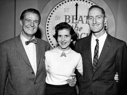 """Then-Municipal Court Judge William Keating and his wife, Nancy, in 1959 participating in an ABC-TV game show, """"Beat the Clock."""" The Keatings, shown with host Bud Collyer, participated in the show, in which prizes were awarded for clock-beating performances of humorous stunts."""