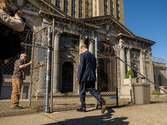 Matthew Moroun walks back to the Michigan Central Station after speaking to press announcing the sale of the station in Detroit to Ford Motor Company on Monday, June 11, 2018.