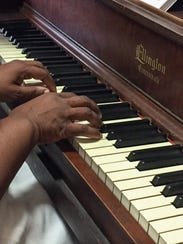 Angela Darwiche-Smith, 55, is taking piano lessons