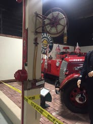 An old fire ax and hose are on display in the First