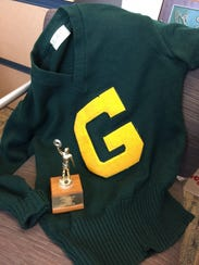 A letterman sweater and trophy were donated by Mike