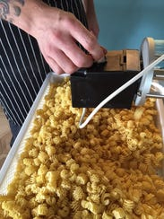 Jianna serves up fresh extruded and egg pastas, as