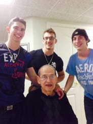 Guglielmo Mammoliti, seated, with his grandsons Alex,