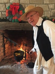 Ray Machar checks the spiced cider at the hearth.