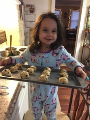 Amelia Saxon, 4, shows off cookies she's baking at