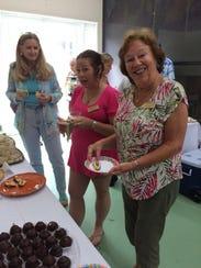 Toni Barnes, Paola Kiriakow, and Mary Ann Curtis enjoy