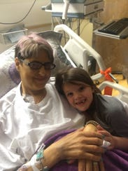 Kaleigh takes a picture with her mother, Angie Kiesgen,