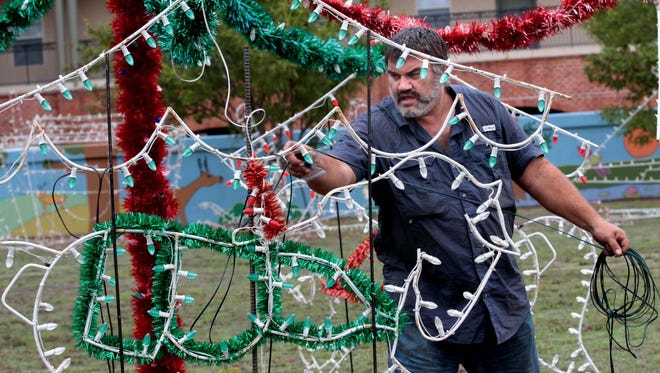 Rick Spillers says it will take until Thanksgiving to put all the lights in place for the West Monroe holiday season.