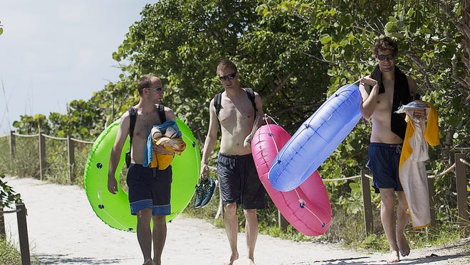 From left, Jan Peppen, Alex Husman and Timm Strobach, all on vacation from Germany leave Bowman's Beach on Sanibel on Wednesday 10/1/2014.