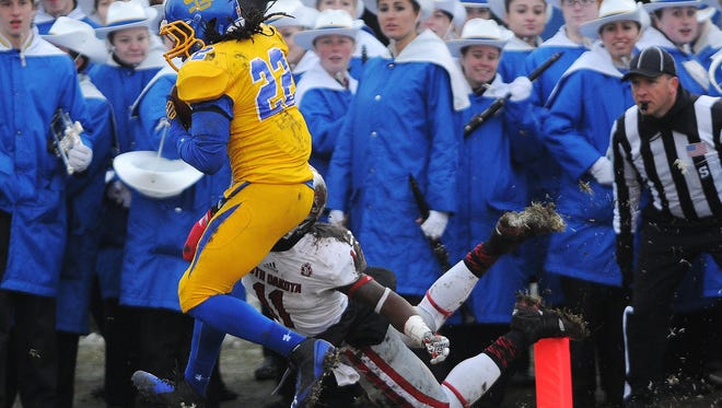 SDSU's Je Ryan Butler (22) intercepts a pass intended for USD's Eric Shufford Jr. (11) during the first half of the South Dakota Showdown Series game on Saturday, Nov. 22, 2014, at CoughlinÐAlumni Stadium in Brookings, S.D.