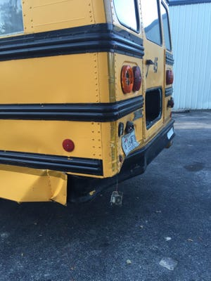 Officials say a truck rear-ended a Stone County school bus sending six children to the hospital.