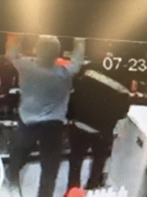 Surveillance footage of a Dover liquor store robbery that happened Saturday.