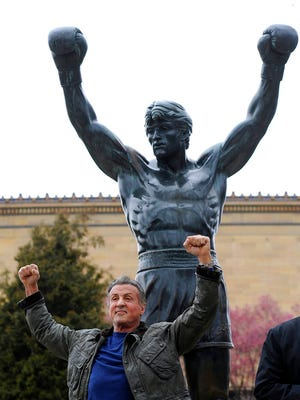 """Sylvester Stallone poses in front of the Rocky statue at the Philadelphia Art Museum at a photo op to promote """"Creed II"""" in Philadelphia on Friday, April 6, 2018. The film, part of the """"Rocky"""" film franchise, will be released later this year."""