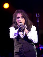 Alice Cooper along with his touring band performs at Alice Cooper's Christmas Pudding Fundraiser concert at the Celebrity Theatre in Phoenix, Saturday, December 9, 2017.