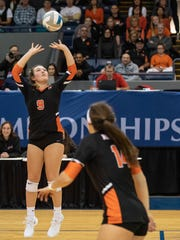 Northville's Emma Stiles (9) makes the pass in Friday's Division 1 girls volleyball semifinal against Rockford at Battle Creek's Kellogg Arena.
