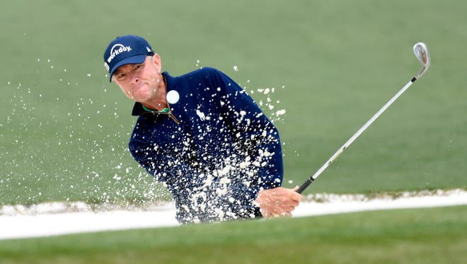 Davis Love III hits out of a bunker on the 2nd hole during the final round of the Masters on April 10.