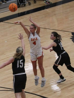 Dale's Jacie McClure (4) launches a 3-point shot between Wright City defenders Briley Walker (15) and Santanna Bunch (14) Thursday night at Dale.