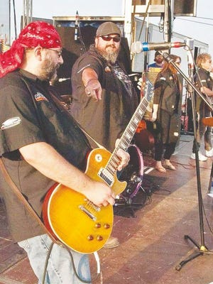 A band of five, Soul Root Band's founder thinks he has captured lightning in a bottle. Pictured: Soul Root Band's founding members Rob Frommel (foreground) and Ron Schieferdecker.