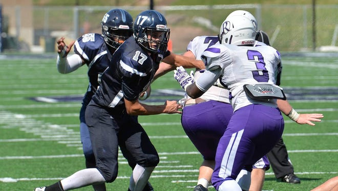 Appleton East graduate Jake Gostisha (17) has moved to defensive end and leads the Lawrence defense in tackles with 26.