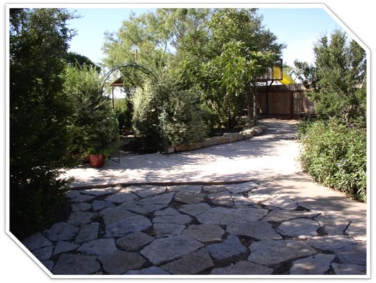 The Flanagan xeriscape yard features natural resources