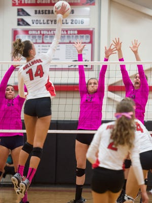 Jensen Beach's (from left) Naiya Sawtelle, Kaylee Oscarson and Jenna Johnson try to block a kill by South Fork's Angela Grieve during the third game of the high school volleyball District 13-7A final Thursday, Oct. 19, 2017, at South Fork High School in Tropical Farms.