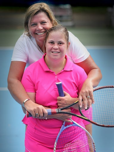 Special Olympian Brittany Norman and her Unified Partner Darcy Bellflower got in one final tennis workout before leaving for the national Special Olympics games in New Jersey on Friday. The two worked out at the tennis courts in Myers Park on Wednesday, June 11, 2014.