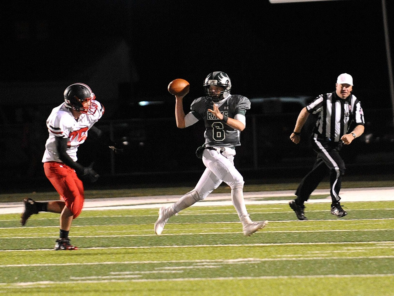 Madison quarterback Tresten Vail attempts a pass against Orrville last week. The Rams travel to Ashland Friday night in a must-win game to stay in the hunt for an Ohio Cardinal Conference championship.