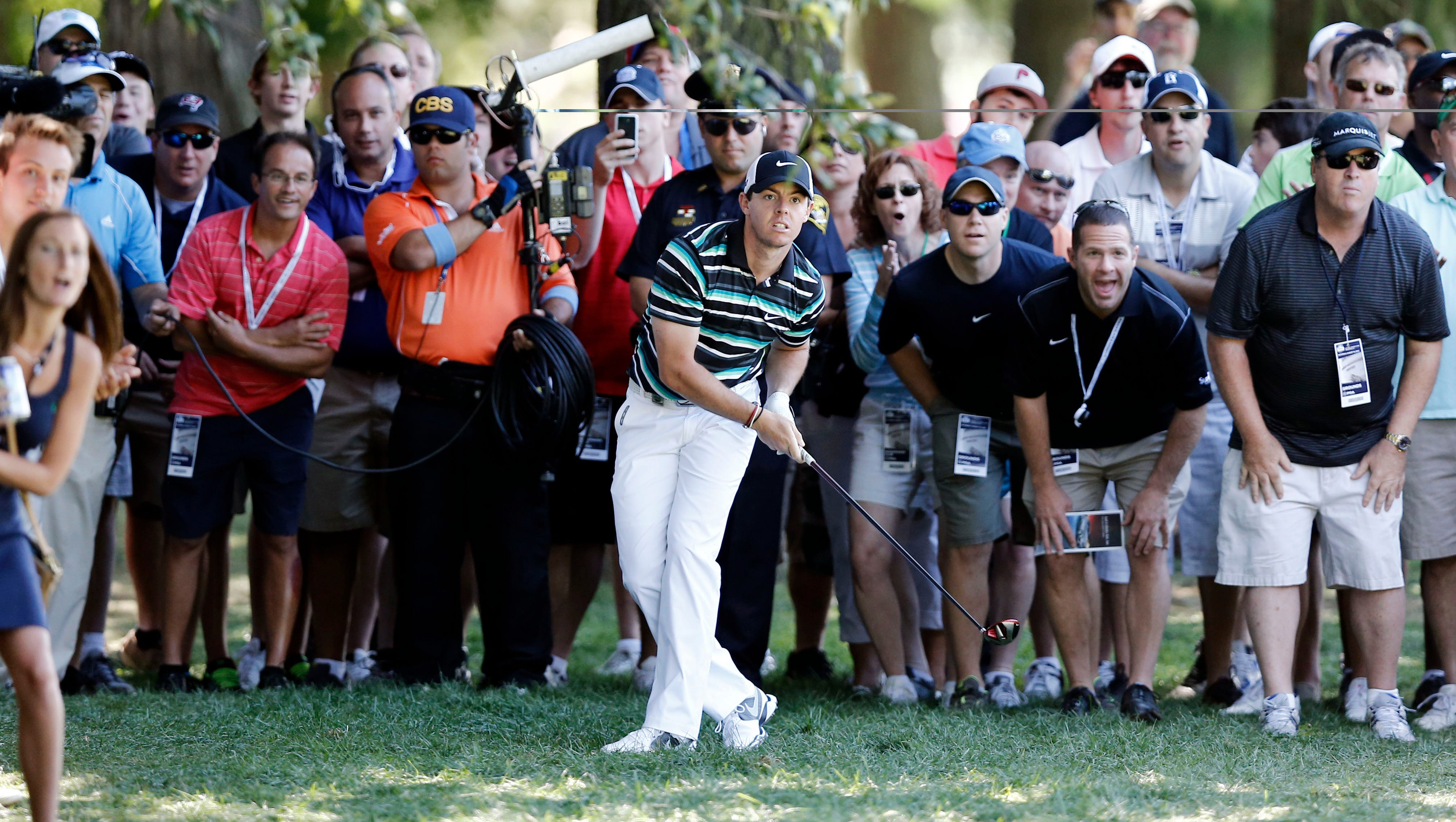 Rory McIlroy tries to bend one out of the rough at No. 4.