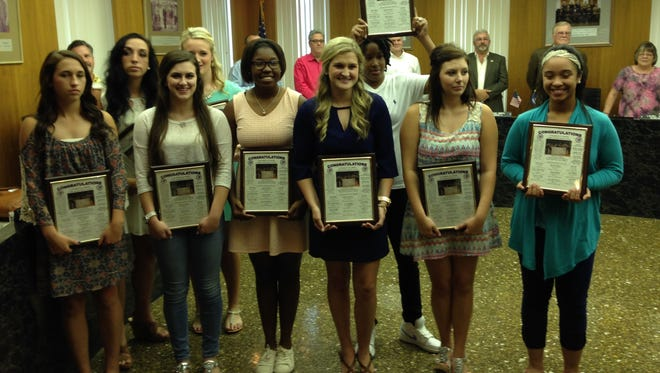 Members of the University Academy Lady Lions basketball team hold plaques given to them by the Rapides Parish Police Jury in honor of them  winning the Mississippi Association of Independent Schools 2015 Class A basketball championship.