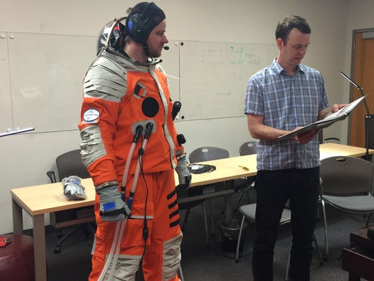 Dr. Ondrej Doule, a professor and researcher at the Florida Institute of Technology, wears the space suit built by Final Frontier Design.
