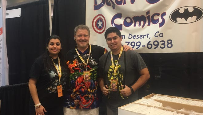 Sid Johnson, owner of Desert Oasis Comics in Palm Desert, poses with two employees at Comic Con Palm Springs.