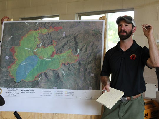 Fire Behavior Analyst Ian Rickert explains why the West Valley Fire has grown during a meeting in New Harmony July 2, 2018.