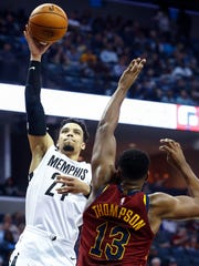 Memphis Grizzlies guard Dillion Brooks (left) drives fro a layup against Cleveland Cavaliers defender Tristan Thompson (right) during first quarter action at the FedExForum in Memphis, Tenn., Friday, February 23, 2018.