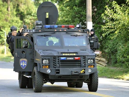 2015 265288084-TDNBrd_05-19-2015_DETROIT_1_A007~~2015~05~18~IMG_Police-Armor.jpg