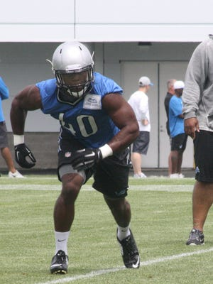 Desmond Martin flares out of the backfield for short pass under the watchful eye of a Detroit Lions coach Wednesday afternoon.