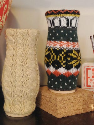 Two sweater vases by Lauren Weege. Cozying up in a favorite sweater is one of the distinct pleasures of autumn. This fall, designers and retailers are stitching up sweater motifs on an array of home decor, too.