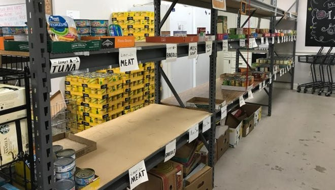 The Dickson County Help Center's food pantry shelf where the following would normally be located: soups, peanut butter, canned meats and vegetables.