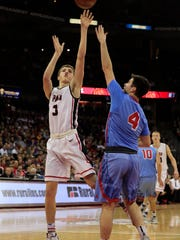 Stevens Point High School's Drew Blair (3) shoots over Arrowhead High School's Tommy Durand (4) in the Division 1 championship game at the 2017 boys basketball state tournament at the Kohl Center on Saturday, March 18, 2017, in Madison, Wis.