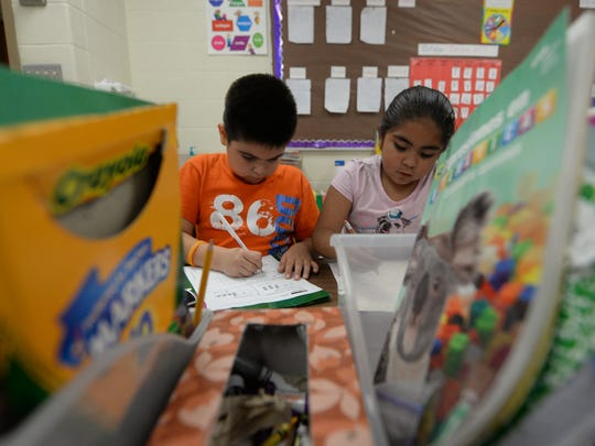 Angel Brayan Vazquez Gallo, left, and Aideliz Del Rio Zambra work during the mandatory homework sessions as part of an after school program at Eisenhower Elementary School in Green Bay.