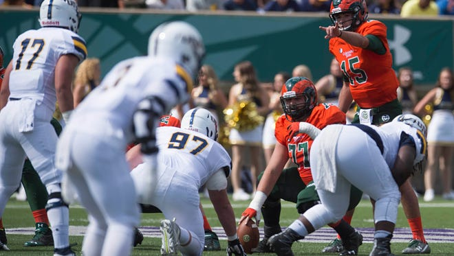 University of Northern Colorado football players line up against CSU and quarterback Collin Hill during a Sept. 17, 2016, game at Hughes Stadium. UNC's scheduled game Saturday at Florida was canceled Thursday because of Hurricane Irma.
