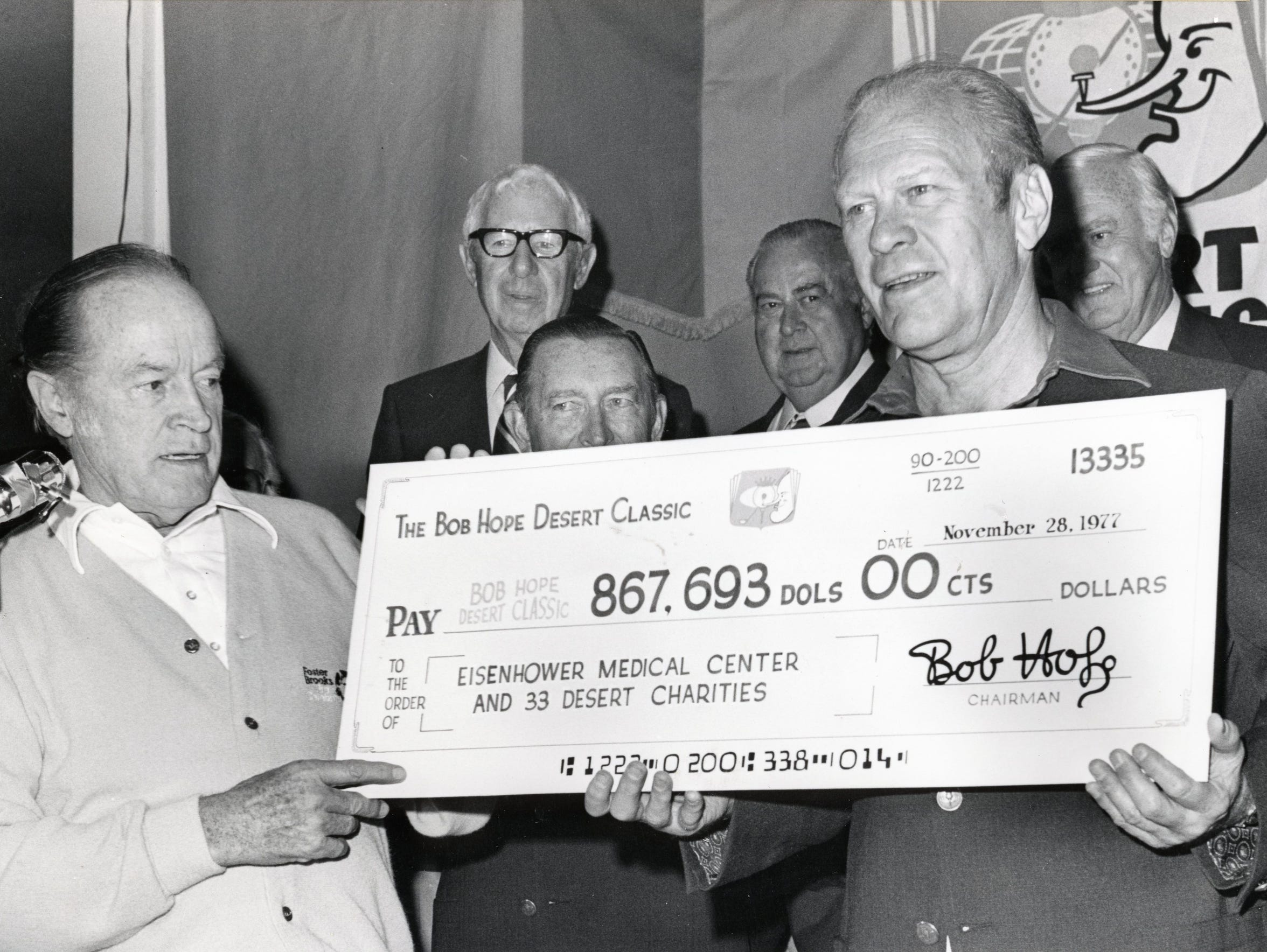 Bob Hope presents President Gerald Ford a check for