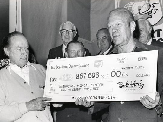 Bob Hope presents President Gerald Ford a check for $867,693 for Eisenhower Medical Center from the Bob Hope Desert Classic.