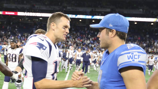Lions QB Matthew Stafford, right, and Patriots QB Tom Brady shake hands after a preseason game Aug. 25, 2017 at Ford Field.