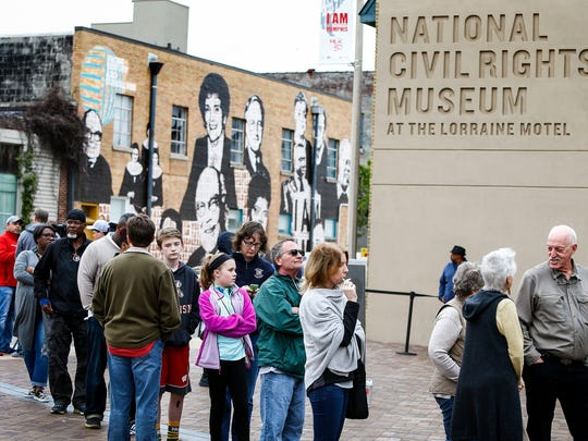 A crowd gathers outside the National Civil Rights Museum,