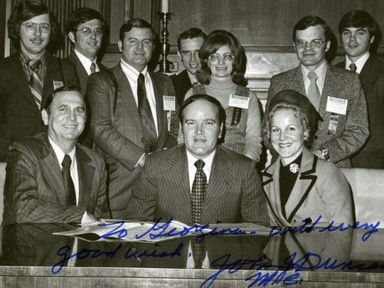"In this photograph from the 1970's during in Washington D.C., Georgiana Vines, center, stands behind Knoxville Mayor Kyle Testerman, seated center, wife Janet Testerman, right, and John J. Duncan Sr. The photographed is signed by John Duncan Sr. and reads: ""To Georgiana, with every good wish."""