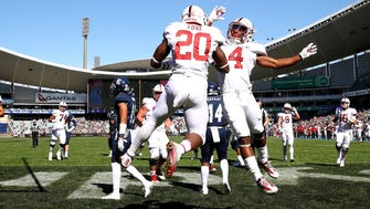 SYDNEY, AUSTRALIA - AUGUST 27:  Bryce Love and Jay Tyler of Stanford celebrate Love scoring a touchdown during the College Football Sydney Cup match between Stanford University (Stanford Cardinal) and Rice University (Rice Owls) at Allianz Stadium on August 27, 2017 in Sydney, Australia.  (Photo by Mark Kolbe/Getty Images) ORG XMIT: 775010097 ORIG FILE ID: 839691358